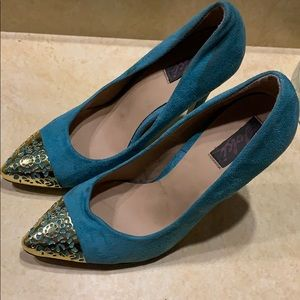Turquoise suede. Gold tipped stilettos